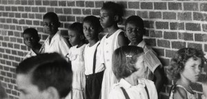Black children stand with their backs against the wall during the first day of school integration in Hoxie, Arkansas, in 1955. (Gordon Tenney.)